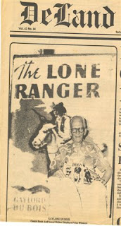 Gaylord DuBois holds up his copy of the dust jacket from the 1st edition of The Lone Ranger