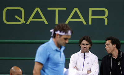Black Tennis Pro's Younes El Aynaoui and Rafael Nadal watch Roger Federer in semifinal round at Qatar Open.