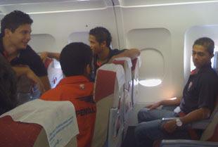 Jogadores no avião