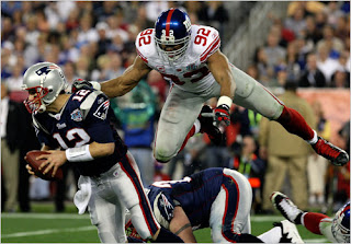 Michael Strahan and the Giants defense successfully pressured Brady in the first half - Photo by Doug Mills NY Times