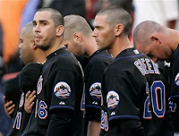 New York Mets' Oliver Perez, second from left, holds his cap over his chest exposing his shaved head while standing for the national anthem with Ramon Castro, far left, John Maine, center, Shawn Green, second from right, and Mike Pelfrey, all whom shaved their heads before playing the Milwaukee Brewers in Major League Baseball action Friday, May 11, 2007, at Shea Stadium in New York. (AP Photo/Julie Jacobson)