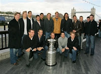 Anaheim Ducks' players pose with the Stanley Cup near Tower Bridge in London, Wednesday Sept. 26, 2007. The Stanley Cup champion Anaheim Ducks have brought the oldest team trophy in North American sports back home to England. The Ducks, who practiced at the O2 Arena for the first time Wednesday, will open the National Hockey League season in the British capital on Saturday against the Los Angeles Kings. (AP Photo/Tom Hevezi)