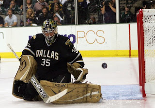 DALLAS - MAY 04: Goaltender Marty Turco #35 of the Dallas Stars makes a save against the San Jose Sharks during game six of the Western Conference Semifinals of the 2008 NHL Stanley Cup Playoffs on May 4, 2008 at the American Airlines Center in Dallas, Texas. (Photo by Ronald Martinez/Getty Images)