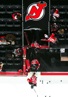 NEWARK, NJ - JANUARY 30: Patrik Elias #26, Andy Greene #6, and Johnny Oduya #29 of the New Jersey Devils take the ice to warm up before playing against the Pittsburgh Penguins at the Prudential Center on January 30, 2009 in Newark, New Jersey. (Photo by Jim McIsaac/Getty Images)