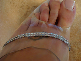 Clear portion with rhinestones on foot