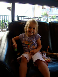 Child with toys sitting and smiling