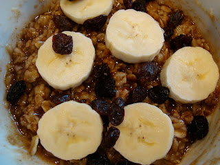 Overhead of Brown Sugar & Cinnamon Raisin Oats topped with bananas and raisins