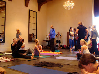 Ballroom full of people on yoga mats