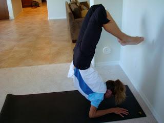Woman doing  Scorpion yoga pose