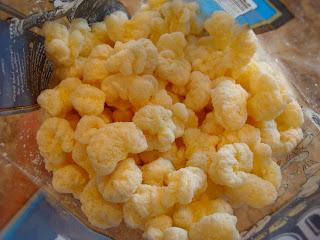 Inside bag of White Cheddar Corn Puffs