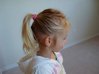 Young girl showing her hair after using conditioner