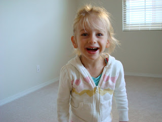 Young girl smiling showing off her hair
