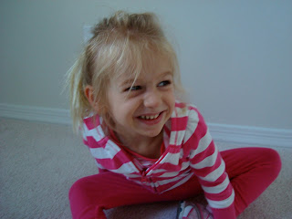 Young girl sitting in room smiling