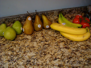 Pears, Bananas, Tomatoes on countertop