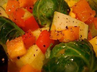 Raw Vegetables dressed in Holiday Orange Spice Vinaigrette Recipe and black pepper