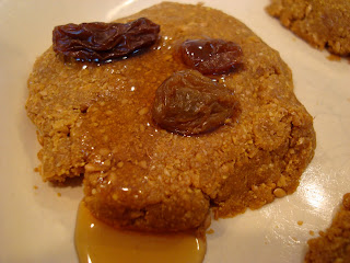 Close up of one cookie with syrup and raisins