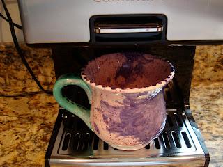 Coffee Maker Brewing coffee into Homemade Mug