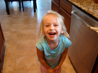 Young child smiling in kitchen