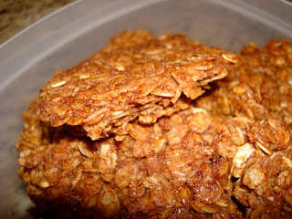 Broken pieces of Homemade Vegan Gluten & Soy Free Granola in clear container