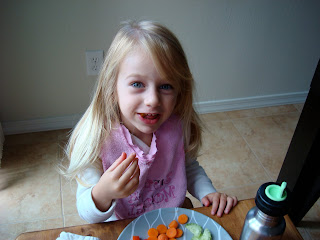 Young girl eating off plate
