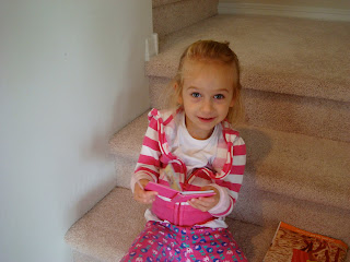 Young girl sitting on steps holding small notebook