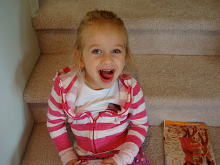 Young girl sitting on steps making silly face