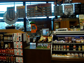 Coffee shop portion of store showing checkout and menus