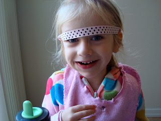 Close up of young girl with headband above eyes smiling