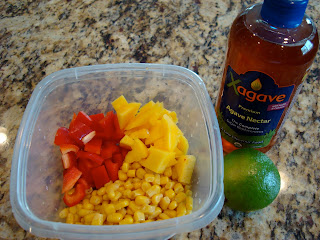 Ingredients to make Sweet Mango & Lime Corn Salsa in clear container
