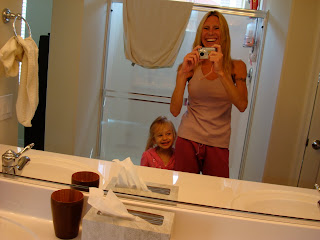 Young girl and lady wearing new yoga gear in bathroom