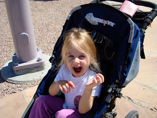 Young girl in stroller smiling