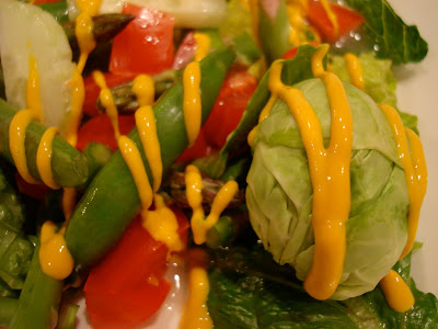 Close up of Salad drizzled with mustard