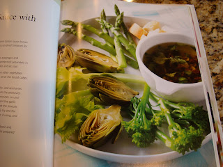 Page in book showing greens with dipping sauce
