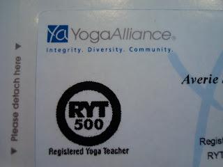 Close up of Yoga Alliance Yoga Teacher Card