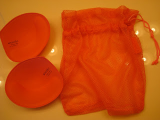 Removable bra inserts next to mesh bag