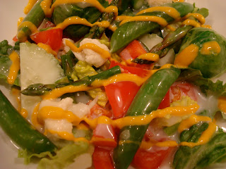 Green salad with vegetables drizzled with mustard