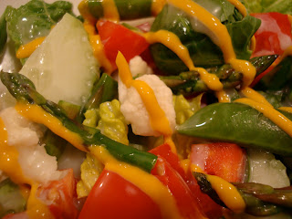 Salad drizzled with mustard