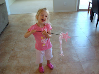 Young girl dancing with princess wand