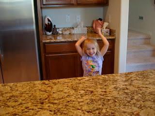 Little girl dancing in kitchen
