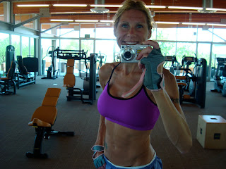 Close up of woman taking photo of self at gym