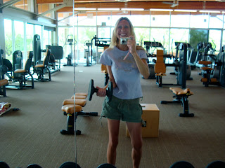 Woman in mirror holding dumbbell
