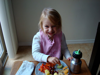 Young girl sitting at table eating