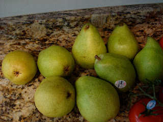 Multiple pears on countertop