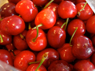 Fresh cherries in container