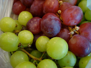 Close up of green and red grapes