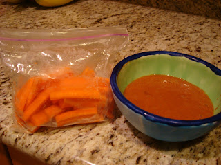Bag of sliced carrots and a cinnamon dipping sauce in blue and green bowl