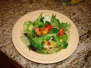 Dressed salad in shallow bowl on countertop