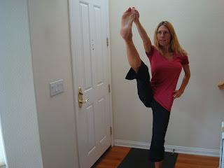 Woman doing Utthita Hasta Pandungustasana yoga pose