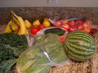 Mixture of purchased fruits and vegetables on countertop
