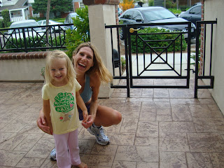 Woman and child smiling on patio